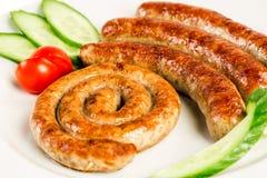 Piec na grillu mięsne kiełbasy Fotografia Stock