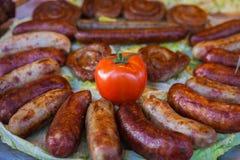 Piec na grillu pomidor i kiełbasy Fotografia Stock