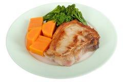 Piec na grillu wieprzowina kotlecik z warzywo posiłkiem Zdjęcia Royalty Free