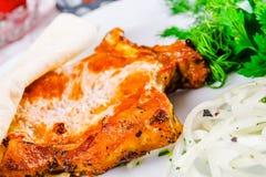 Piec na grillu wieprzowiny loin na kości Zdjęcia Stock