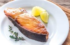 Piec rybi stek z cytryną zdjęcia royalty free
