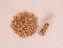Piec soje i drewniana łyżka Obrazy Stock