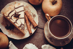 Piece of almond cheesecake and cinnamon stock image