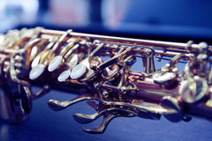 Piece of alto saxophone. Shiny golden alto saxophone with detailed view of keys royalty free stock photography
