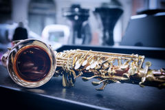 Piece of alto saxophone. Shiny golden alto saxophone with detailed view of keys Royalty Free Stock Image