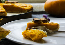 A piece of the American pie with pumpkin. Thanksgiving Day. autumn cake Royalty Free Stock Photo