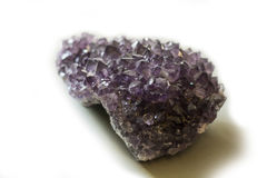 Piece of amethyst crystal in studio shot Royalty Free Stock Photography
