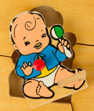 Piece of an antique wooden puzzle for children Stock Photography