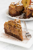 Piece of apple and caramel cake on white plate. Vertical Royalty Free Stock Images