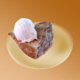 Piece of Apple Pie. Slice of apple pie on plate which is soft focus Stock Photo
