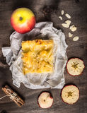 Piece of apple pie with almonds and cinnamon Royalty Free Stock Photography