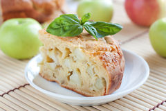 Piece apple pie on the background of  apples Stock Photos