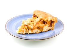 Piece of apple pie on blue plate. Isolated on white background stock photo