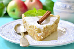 Piece of apple pie with cinnamon. Piece of apple pie with cinnamon on a white plate Stock Photos