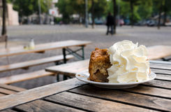 Piece of an apple pie with cream in a cafe in Amsterdam Royalty Free Stock Photography