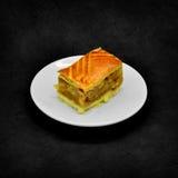 Piece of apple pie on a dark grunge background Stock Image