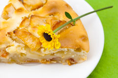 Piece of apple pie and a flower Royalty Free Stock Photos