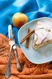 A piece of apple pie lying on blue plate, apple, cinnamon sticks Stock Photo