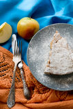 A piece of apple pie lying on blue plate, apple, cinnamon sticks Royalty Free Stock Photography