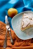 A piece of apple pie lying on blue plate, apple, cinnamon sticks Royalty Free Stock Photos