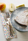 A piece of apple pie lying on the gray plate, apple, fork Stock Photos