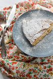 A piece of apple pie lying on the gray plate, knife Stock Photography