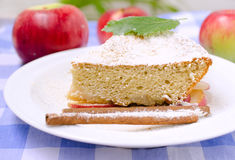 Piece of apple pie. A piece of apple pie on a plate with cinnamon and mint royalty free stock photo