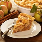 Piece of an apple pie on a plate. Fall baking concept Stock Image