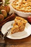 Piece of an apple pie on a plate. Fall baking concept Stock Images