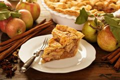 Piece of an apple pie on a plate. Fall baking concept Stock Photography