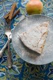A piece of apple pie plate lying on gray, cinnamon sticks, apple Stock Images