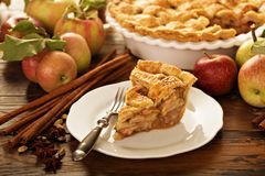 Piece of an apple pie on a plate. Fall baking concept Royalty Free Stock Photo