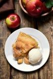 Piece of apple pie served with ice cream, fruit baking Stock Photos