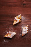 Piece of apple pie on the table Stock Image