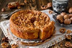 Piece of apple pie with walnut and sugar glaze Stock Photography