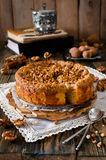 Piece of apple pie with walnut and sugar glaze Stock Images