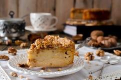 Piece of apple pie with walnut and sugar glaze Stock Photo