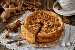Piece of apple pie with walnut and sugar glaze Royalty Free Stock Image