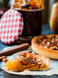 Piece of apple tart on a sand base with caramel Royalty Free Stock Image