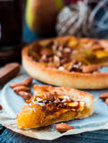 Piece of apple tart on a sand base with caramel Stock Photography