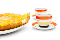 Piece of apricot cake and cups of tea Royalty Free Stock Photo