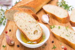 Piece of baguette in a fragrant olive oil, spices, garlic Royalty Free Stock Photography