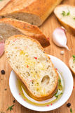 Piece of baguette in a fragrant olive oil, spices and garlic Stock Images