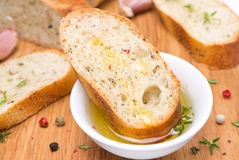 Piece of baguette in a fragrant olive oil and spices Royalty Free Stock Photo
