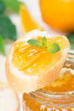 Piece of baguette with orange marmalade Royalty Free Stock Photos