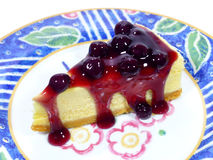 Piece of baked cheesecake with blueberry sauce Royalty Free Stock Image