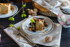 A piece of banana biscuit cake, poured with chocolate, on a plate Royalty Free Stock Photography