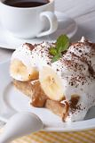 Piece of banana cake with cream and coffee close-up Royalty Free Stock Photography