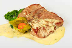 Piece of Bavarian roasted pork in beer sauce. Big and juicy piece of Bavarian roasted pork in a classic, authentic beer, white sauce. served with parsley and Royalty Free Stock Images