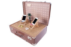 Piece of the beach with two mobile phones in toy beach chairs Royalty Free Stock Photo